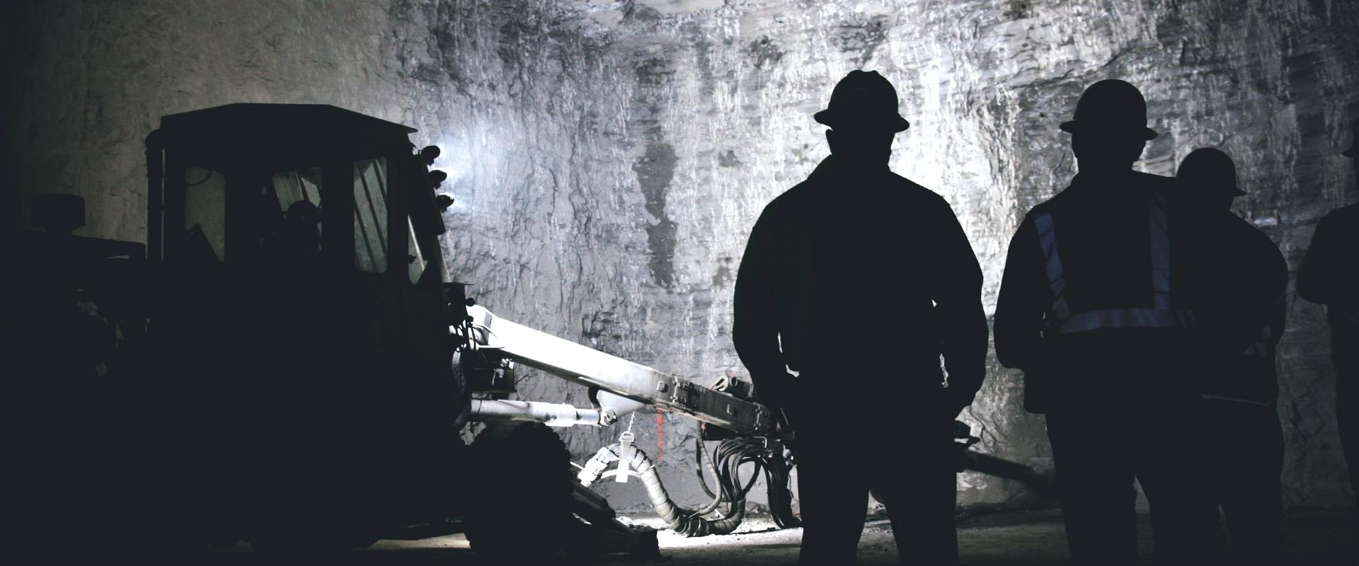 men working in an underground mine