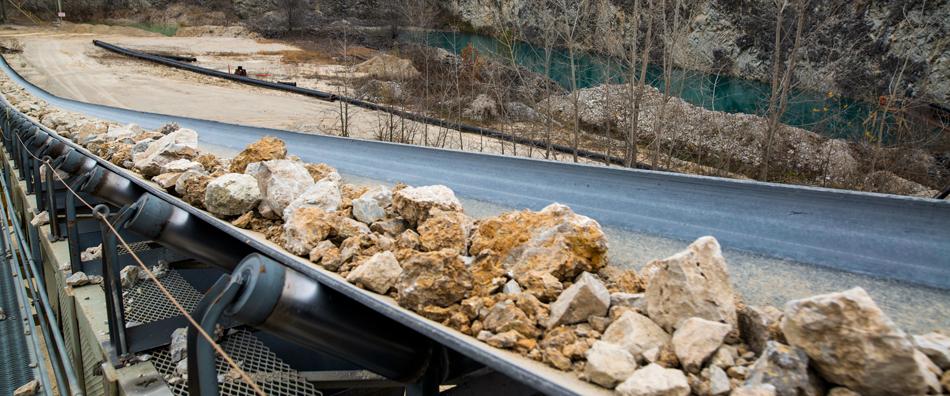 Header photo of rock on a conveyor